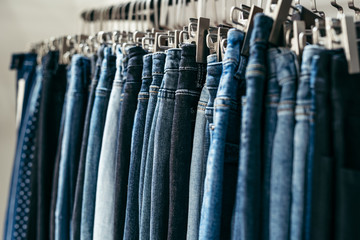 Blue jeans hanging in store