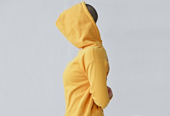 Anonymous woman in yellow hoodie