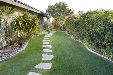 Landscaping with stone pathway in grass at luxury resort