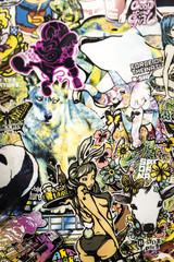 In de dag Graffiti stickers and graffiti on the wall