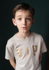 Portrait of a handsome tween wearing a VIP motif t-shirt