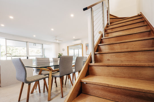 Wooden staircase in living room inside modern home