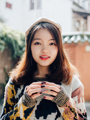 Asian teenage girl portrait with colourful painted nails