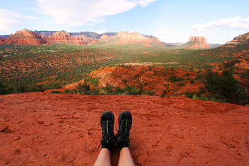 A hiker sits on top of cathedral rock after hiking it.