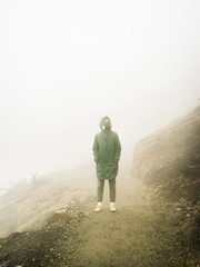 Person in misty vapors of sulfur