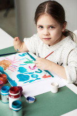 Amputee girl at drawing class