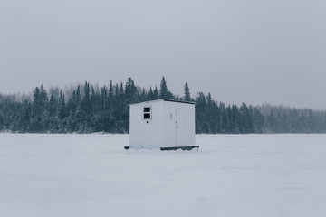 Fish house on frozen lake.