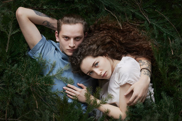 Beautiful couple among fir twigs