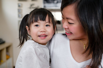 Asian Mother and Daughter Spending Time Together at Home