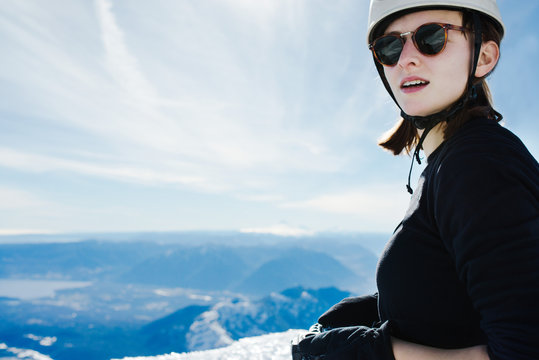 Portrait of a woman on the summit of a snow covered mountain
