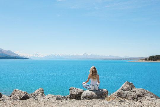 Woman soaking up scenic view at lake