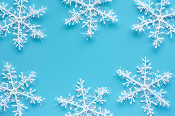 Xmas snowflake ornaments and decoration on blue background for Christmas day and holidays concept