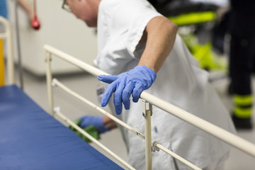 A nurse cleaning a hospital bed