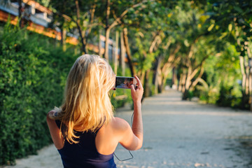 Woman Taking Pictures with her Phone