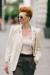 Portrait of a attractive senior woman walking on the street