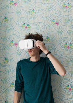 Man wearing VR goggles at home