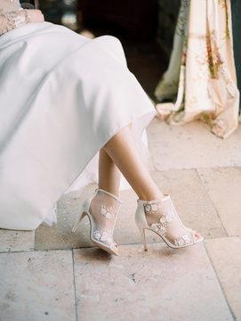 Legs of woman in white dress