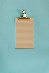Recycled paper and golden metal clamp