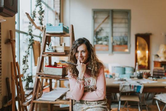 Woman painting in her art studio