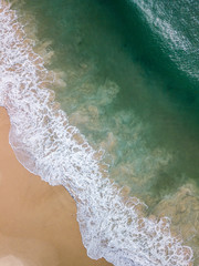 aerial view of beach and surf