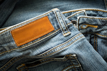 Blue jeans pants with back pocket and empty brown leather tag