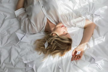 Woman Lying on Bed in the Morning