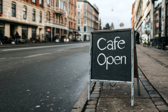"""Open"""""""" sign outside a cafe"""