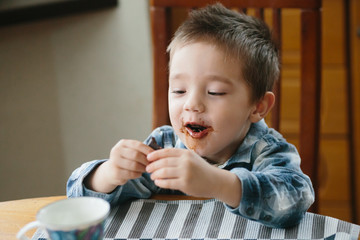 Little boy eating chocolate