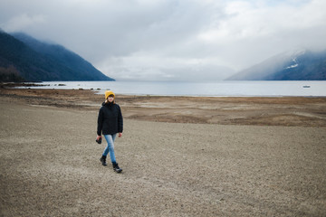 Portrait of a woman exploring a lake in Patagonia