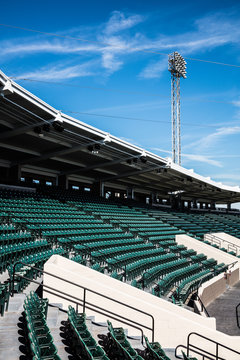 Empty baseball stadium seating on beautiful sunny day with blue skies