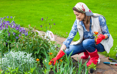 woman in the image of a gardener planting
