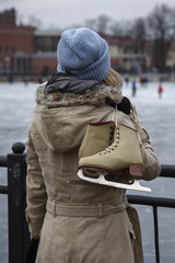 Woman with skates looking at rink