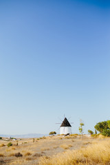 Windmill and old house in Spain