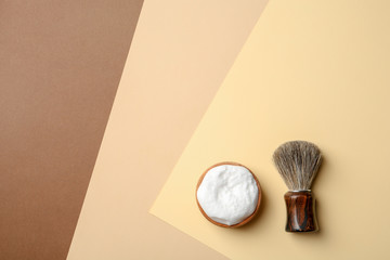 Flat lay composition with men's shaving accessories and space for text on color background