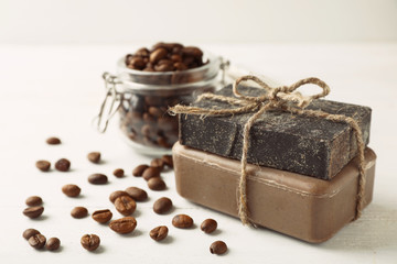 Wall Mural - Handmade soap bars and coffee beans on white table