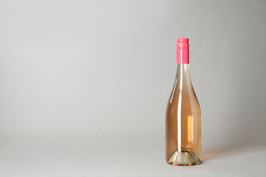 Bottle of wine on grey background. Space for text