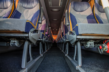A row of empty seats in a bus