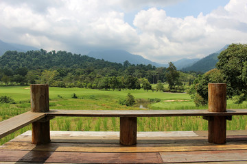 Scenery from a view point of rice fields, golf course, forest and mountains in Khao Soi Dow District of eastern Thailand.