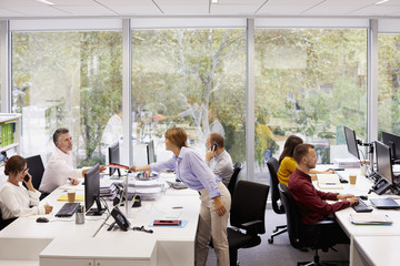 Business Colleagues Working At Desk In Office
