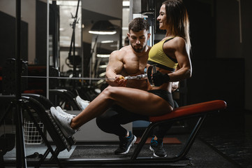 Model young man and woman working out in gym