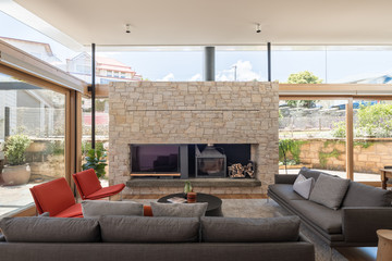 Luxurious lounge interior with stone fireplace