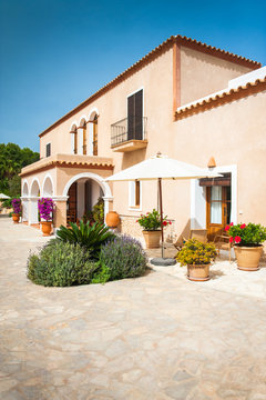 Spanish style home with colorful flowers and plants