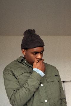 Thoughtful black man biting nails
