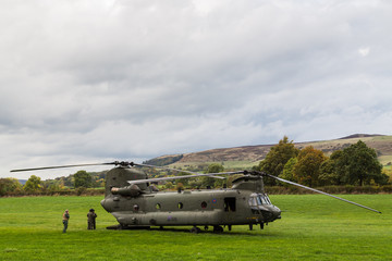 The crew outside a Royal Air Force CH-47-HC.6A Chinook helicopter after its temporarily grounded following a bird strike during low level flying in the Peak District on 11 October 2018.