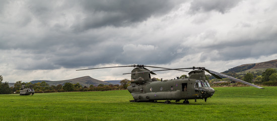 Two Royal Air Force CH-47-HC.6A Chinook helicopters in a field after the front one hit a bird during low level flying...Seen from the roadside near Bamford in the Peak District on 11 October 2018.