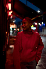 Portrait of a stylish woman during nightlife in the city