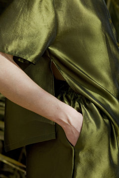 hand in pocket of green trousers