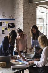 Creative team at work in a modern space