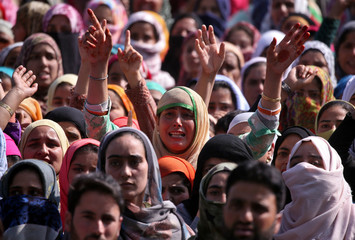 Women shout slogans as they gather before the funeral of Shabir Ahmad Dar, a suspected militant, who according to local media was killed in a gunbattle with Indian security forces, in Samboora