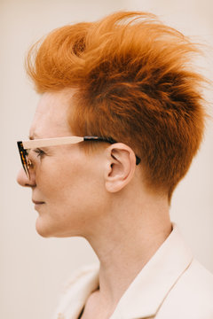 closeup of woman of fifty years with red hair
